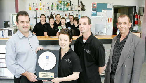 Excellence: TAFE teachers of hospitality Paraic Kavanagh, left, and Lee Fudge, right, with students Tracey Wilks and Adam Bennison.