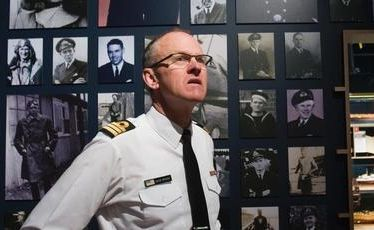 Commander David Wright inside a room at the Navy Museum dedicated to sailors who lost their lives.