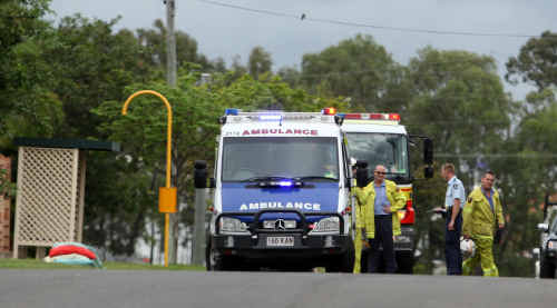 Emergency services personal work at the scene where a girl was hit by a car yesterday. The girl, 12, was taken to Rockhampton Hospital after the collision.