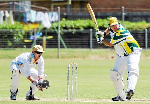 Australs batsman Paul Mathiesen prepares to play his stroke as ATW keeper Brendan Prossliner waits.