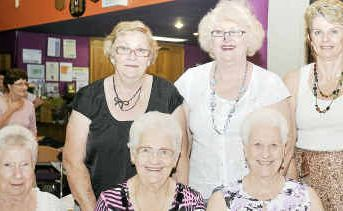 (back, left) Gwin Younger, Jan Ryan, Pat Jefferis, Donna Spence, (front, left) Lyn Robson, Vicki Callinan, Shelley Cope and Norma McLeod at the Pink Ribbon Breakfast for Breast Cancer at the Gladstone Golf Club on Saturday.