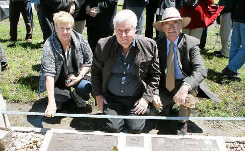 Karen Taylor, John Hoffman and Mayor Ron Bellingham in front of the plaque dedicated to the Hoffman and Xander families at the weekend.