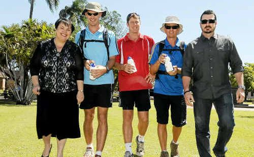 Mayor Lorraine Pyefinch and President Of Bundaberg Minister Association, Pastor Mark Riddell (far right) with Dave and Andrew Carnell and Andrew Sav, who are walking from Cains to Stanthorpe to raise Bible awareness.