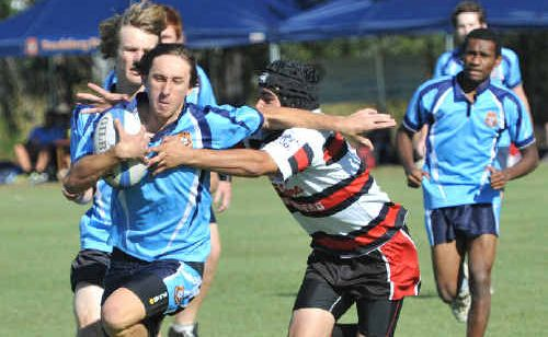 Chris Rose, of Bundaberg High, escapes the tackle by Philip Fletcher, of Shalom Red.