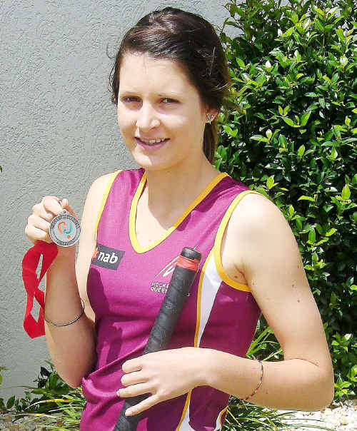 Katie Steemson shows off her silver medal from the Australian Under 15 Girls' Hockey Championships which was held in Darwin.