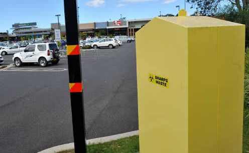 Michelle Egan wants this sharps disposal bin in Toormina moved after her son Max suffered a needle stick injury in the playground of a nearby preschool.