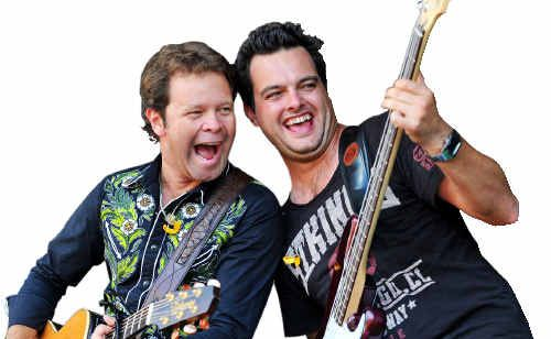 Luke Austen performs with Troy Cassar-Daley at the Whittlesea Music Festival.
