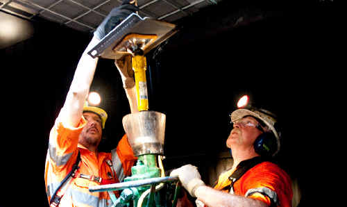 Myne Start student Brad Purdon, left, is taught in the underground coal mining training facility by Bill Reed.