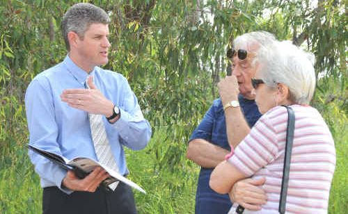 Minister for Infrastructure and Planning Stirling Hinchliffe chats with Gladstone locals Bob and Jean Warren at Clinton on Monday morning.