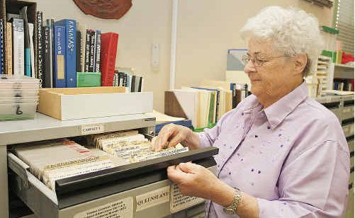 Kay Gassan looks through the files of births, deaths and marriages.