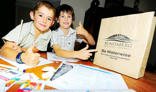 George and Darcy Simmonds have some water wise fun with a sample bag from Bundaberg Regional Council during Water Week.