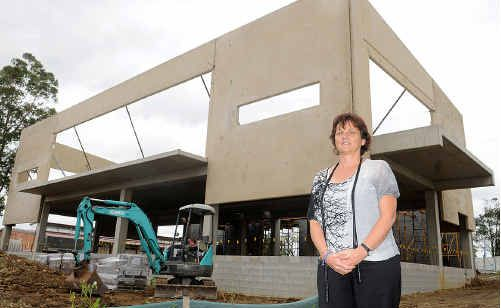 Kathy Fuller stands in front of Saint Patrick's Primary school's new Trinity Building.
