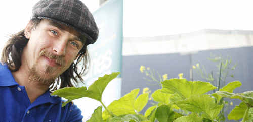 SUSTAINABLE LIVING: Jed Tissott, from Southern Cross University, at the aquaponics display at the North Coast National.