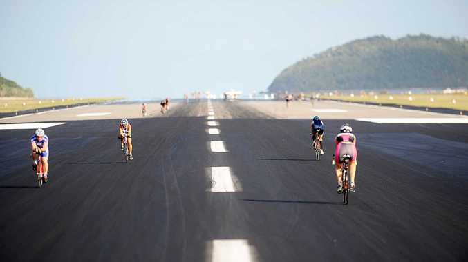 Competitors cycling on the Great Barrier Reef Airport on Hamilton Island as part of last years triathlon.