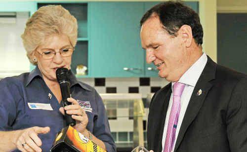 Noelene Fogelis presents the Mayor of Ipswich, Paul Pisasale, with a bottle of Bundaberg Rum at the Urban Development Institute of Australia lunch.
