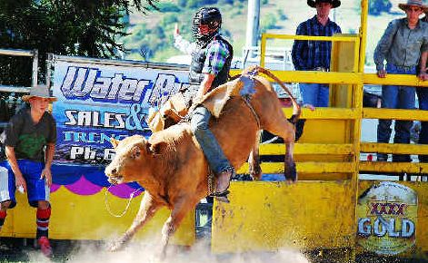 Joshua Lock, 17, of Wardell, has no trouble staying on this bucking bull and taking out the 2nd Division Bull-Ride.