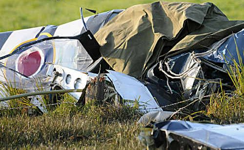 The crumpled cockpit of a crashed replica Spitfire in a cow paddock at Lagoon Pocket on Friday.