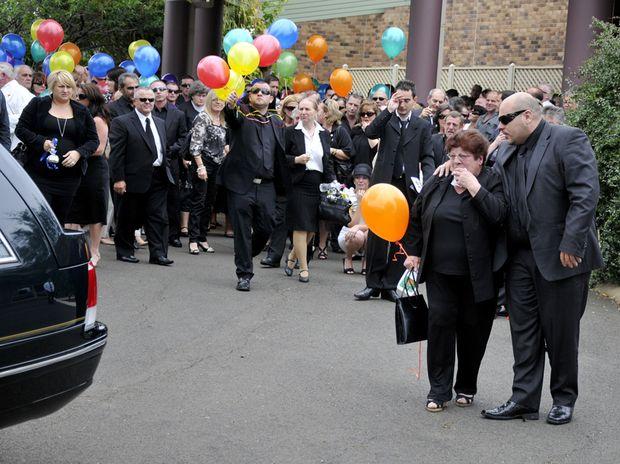 Hundreds of people gather at the Toowoomba Community Baptist Church to farewell champion jockey Stathi Katsidis.