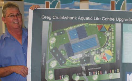 Isaac Regional Council Deputy Mayor Roger Ferguson with the proposed plan for the upgrade of the Greg Cruickshanks Aquatic Centre.