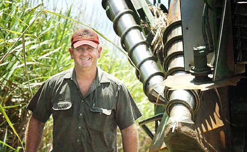 Darryl Cronau, on his Yerra cane farm, wishes he could save all the recent rain for when it's needed.
