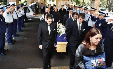 NSW Police Force form a guard of honour at the funeral of Richard 'John' Blackler as his family enters the Lismore Memorial Gardens Chapel,Wednesday, October 27, 2010.