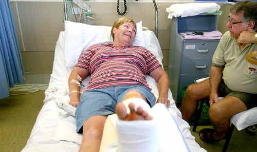 Carol Davey recuperates in Mackay Base Hospital with her husband Merv Davey.