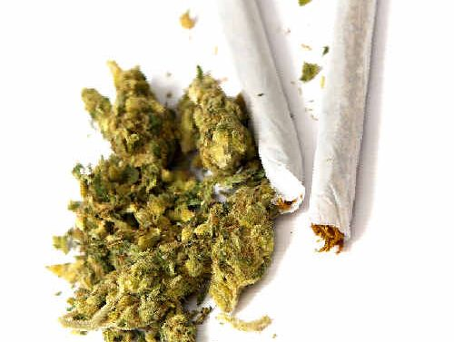 A BEERWAH woman will face court after police caught her smoking marijuana in her car.