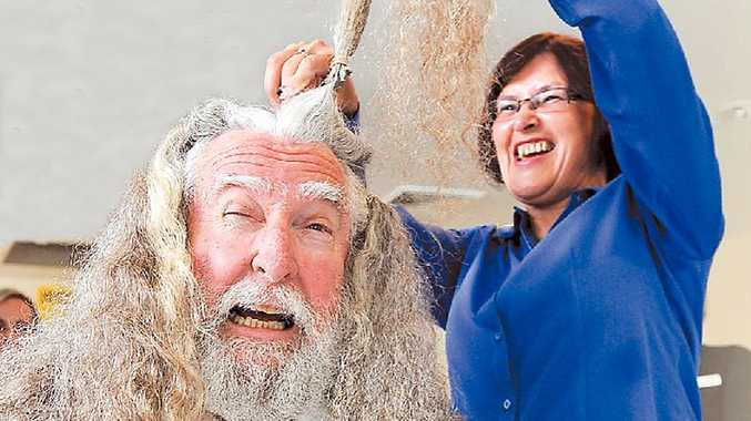 Coffs Harbour's Chris Hales gets the chop for charity after agreeing to shave off his 30cm mane, snowy beard and moustache to raise almost $5000 for beyondblue.