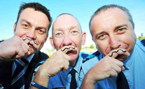 Detective Sergeant Cameron Schneider, Senior Constable Blane Crozier and Sergeant Marty Arnold make a move for Movember in support of men's health.
