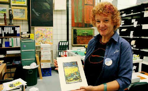 Brigitte Zimmermann holds up the winning entry from last year's competition, This Was Almost Ned 5, by Martin Francis. The form of art is known as Digetch.