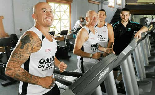 Jacob Yarrow, Dave Quaile, Josh Garden and gym manager Damian Evans inside the Improvements Fitness Centre where the 12-hour challenge, which raised $1000 for the Cancer Council, took place.