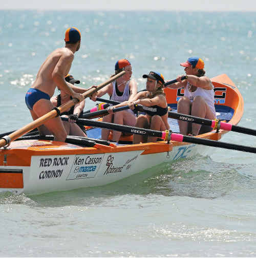 Red Rock open men's under-19 and women compete in the surf boat series at Arrawarra Headland.