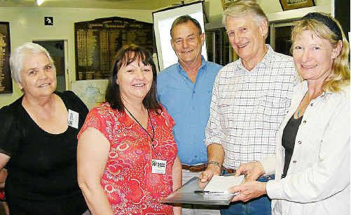 From left - Habitat for Humanity Gympie chapter representatives Inge Schilling and Kim McDonaled discuss new ideas with Bob Whitlock, Graeme Elphinstone and Glenda Pickersgill.