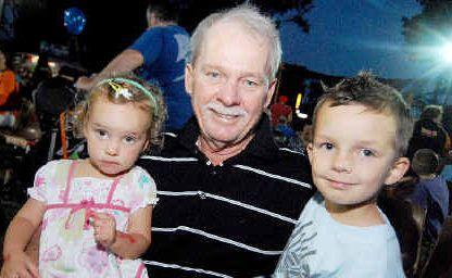 Ross Cran with grandkids Orlando and Matilda Cran at the West Mackay Rotary Club Fair.