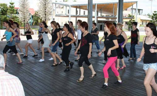 Bluewater Quay was buzzing with funky tunes and groovy dance moves as professional Latin dancers took a group through basic and advanced dance moves.