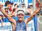 Courtney Atkinson celebrates his third win in the Noosa Triathlon.