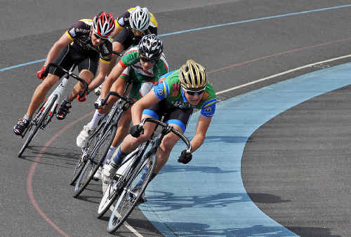 Great success: Racing on corner in the 2010 NSW Track Championships held at Toormina velodrome.