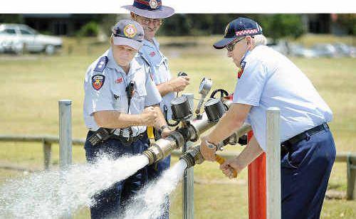 PCYC - (centre) Michael Corser (acting mgr Community Safety Operations) oversees the testing of the fire hydrants with pressure and flow meters.