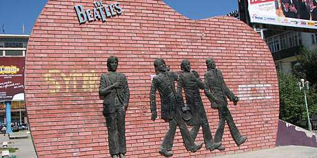 The guitar shaped wall represents the division young Mongolians felt from the West during rock 'n' roll's golden age.