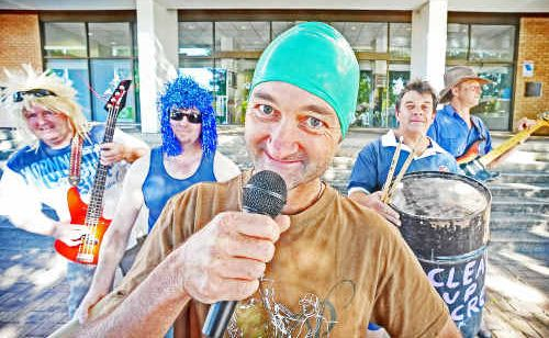 Peter Garrette (Scott Lenton) will front the Castrol Oils Ain't Oils Band during the Clarence Valley Council's Hey Hey It's Jacaranda Thursday Purple Faces performances from 8.15am today in front of the Civic Centre.
