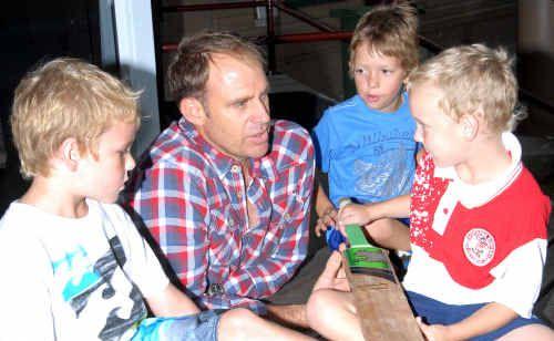 Matt hayden in mackay chats to fans and local junior cricketers from left Luke Bridger, Zane Newton and Harry Bridger.