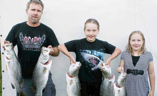 This haul of barramundi was weighed in by, from left, James Arena, Jeremy Arena and Emma Arena.