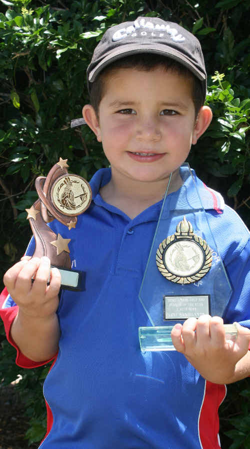 TOP SHOT: Four-year-old Levi Sandilands with his Monthly Medal and Player of the Year awards from the Tieri Golf Club.