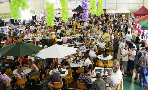 HERE'S CHEERS: Food lovers enjoy the atmosphere at a previous Tenterfield Food and Wine Festival.