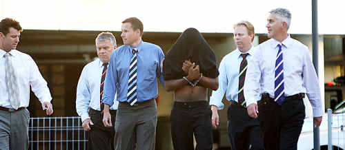 David Samuel Aubrey Ray (pictured with face covered) will face trial for the rape and murder of a Rockhampton grandmother.
