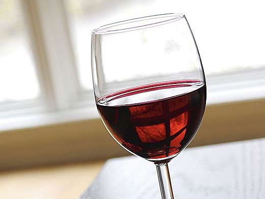 The study has found those who have a regular glass of red wine with their evening meal had healthier blood fat profiles.