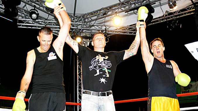 Airlie Beach amateur boxer James Eyles (bearing a dislocated shoulder) with special guest referee Danny Green and fellow Whitsunday boxer Craig Korn following their exhibition bout at Trouble in Paradise.