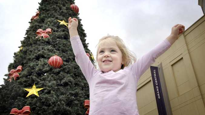 Catilin Easterbrook, 3, admires the freshly decorated Grand Central Christmas tree in Toowoomba.