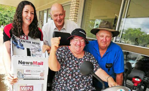 NewsMail Brand sales co-ordinator Angela Childs and Mobility Aid Supplies owner John Humber congratulate Hazel and Robert Page in winning the Aviator S8X.