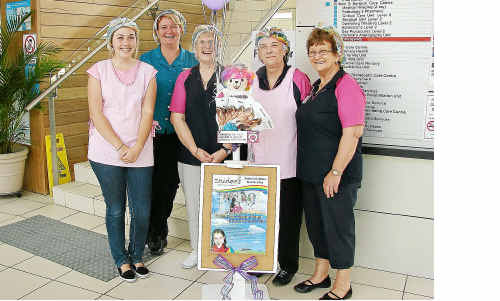 Staff from Coffs Harbour Health Campus wearing rainbow hair nets to promote organ and tissue donation.